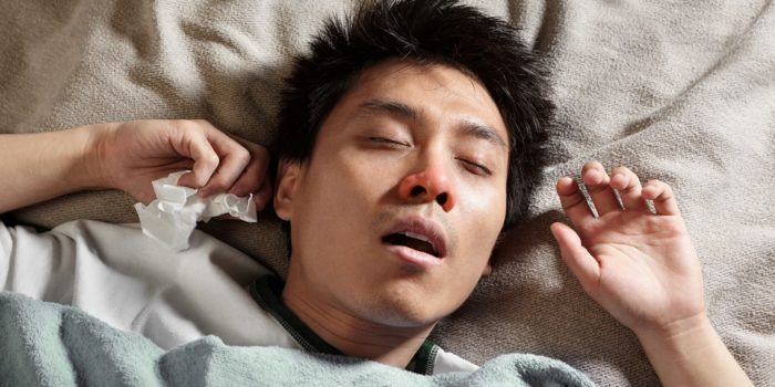 A male Chinese man is sleeping while catching cold and breathing